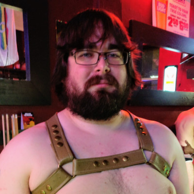 Old picture of me trying on a nice leather harness at the gay bar