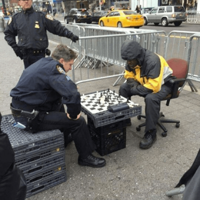 NYPD Officer beating Unarmed Black Man while another Officer stands idly by.